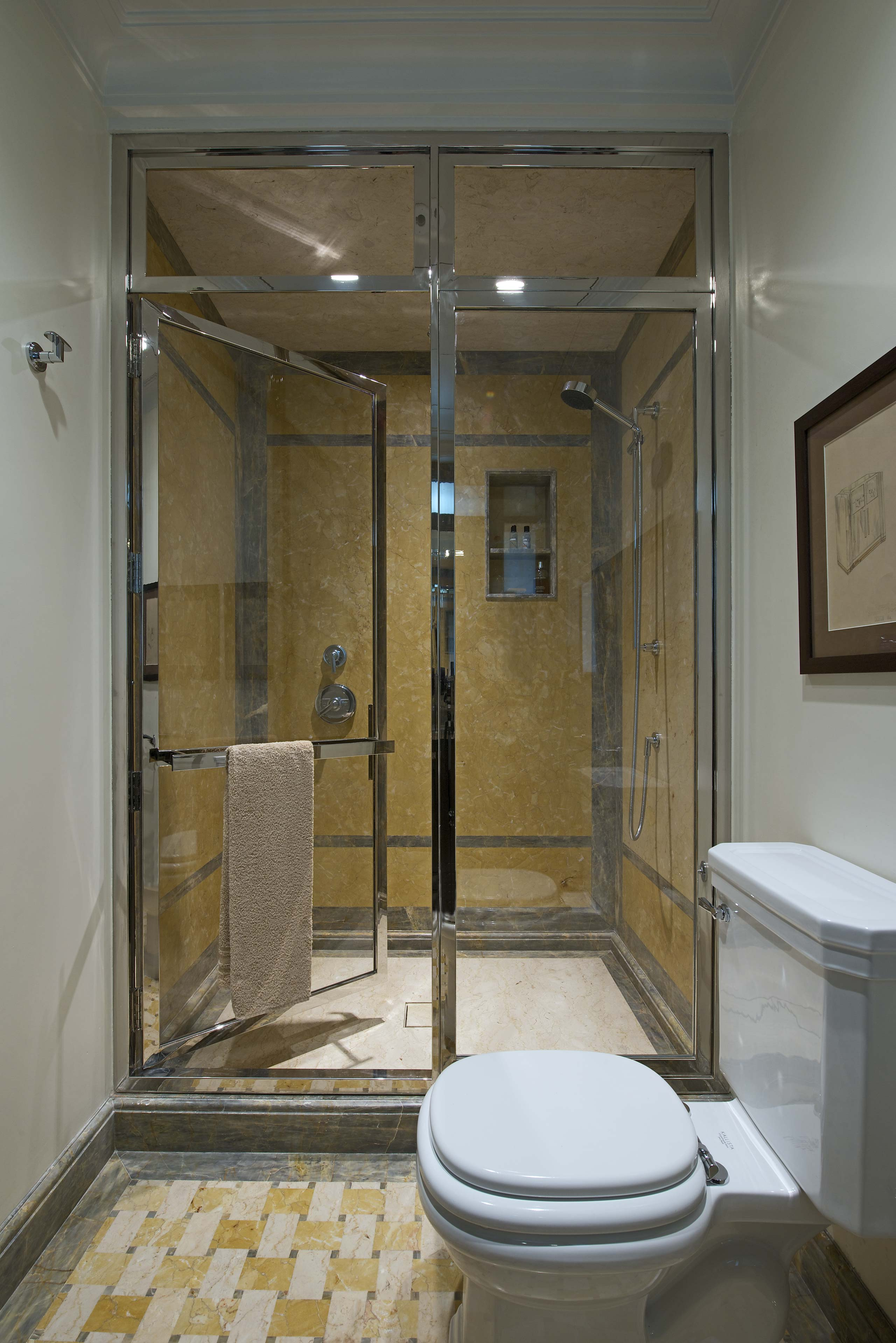 Bathroom in Marble and Glass Door at duplex apartment interior design mumbai india