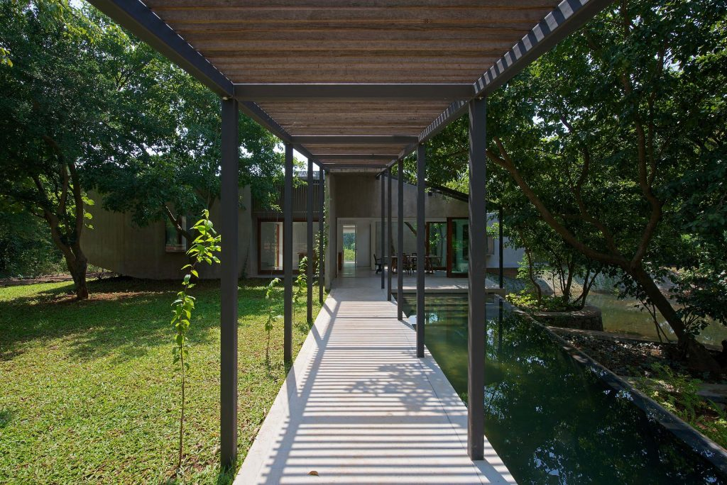pool pergola house on a stream by architecture firm in Mumbai