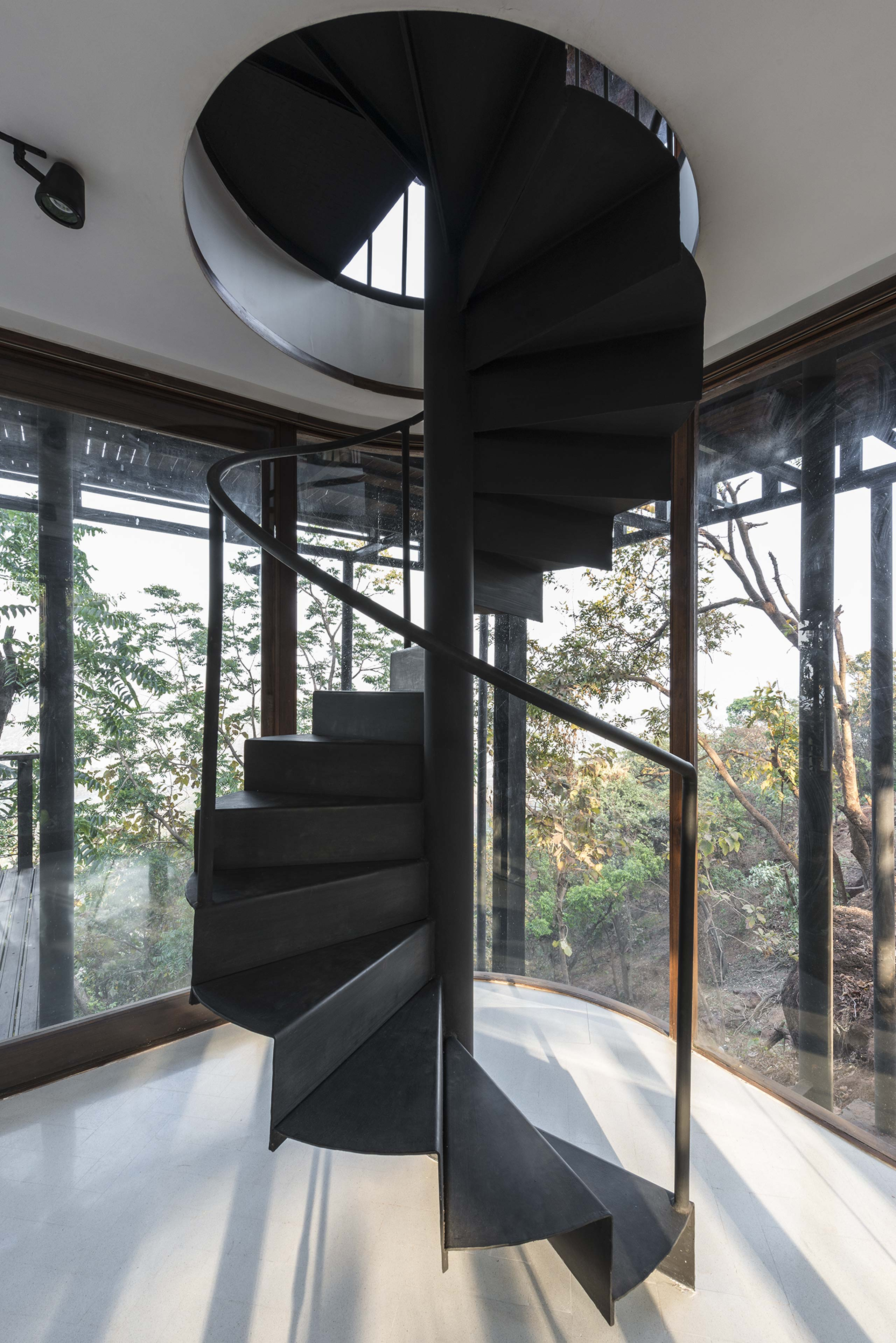 black spiral staircase at tala treehouse villa alibaug india