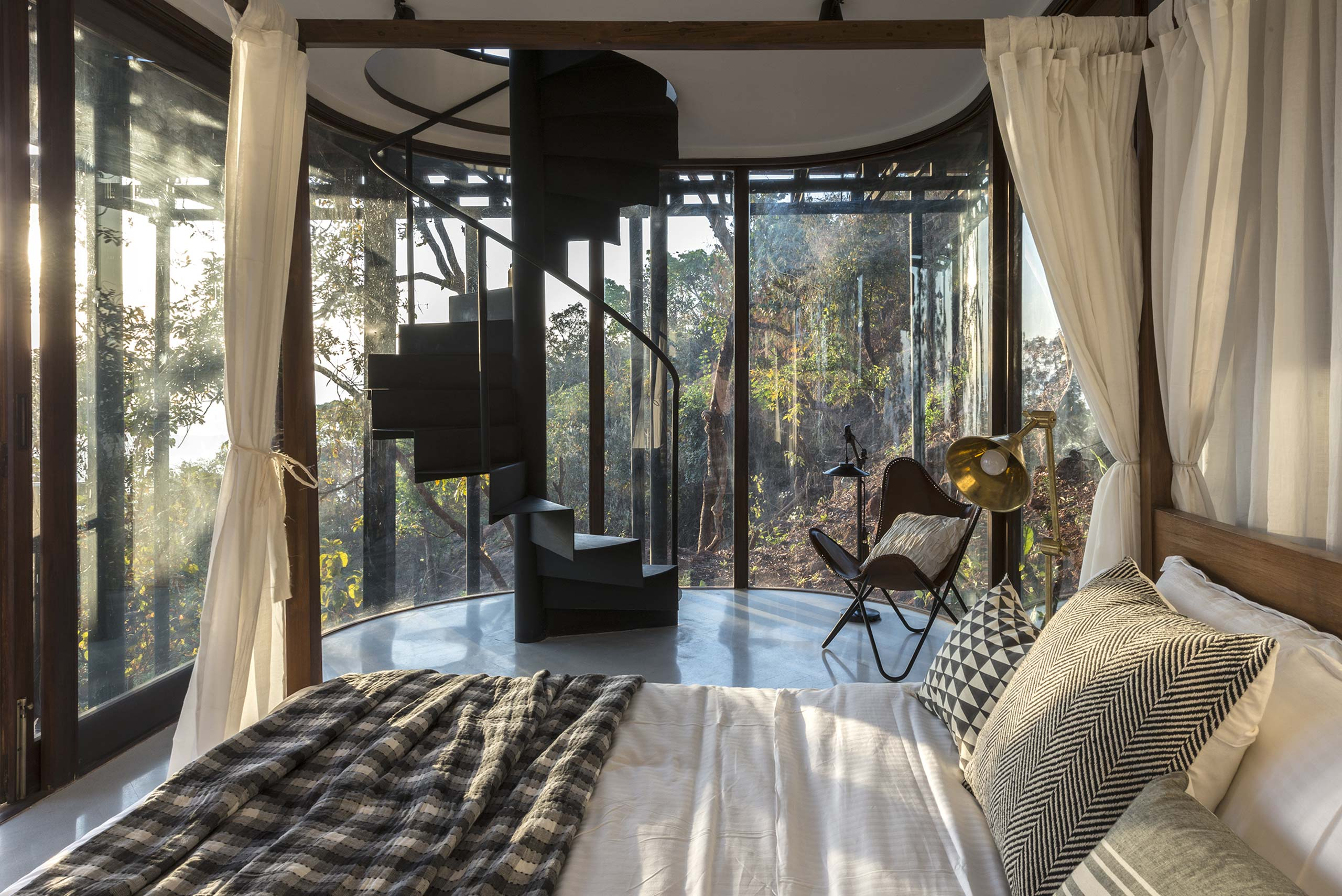 bedroom with curved glass tala treehouse villa alibaug india