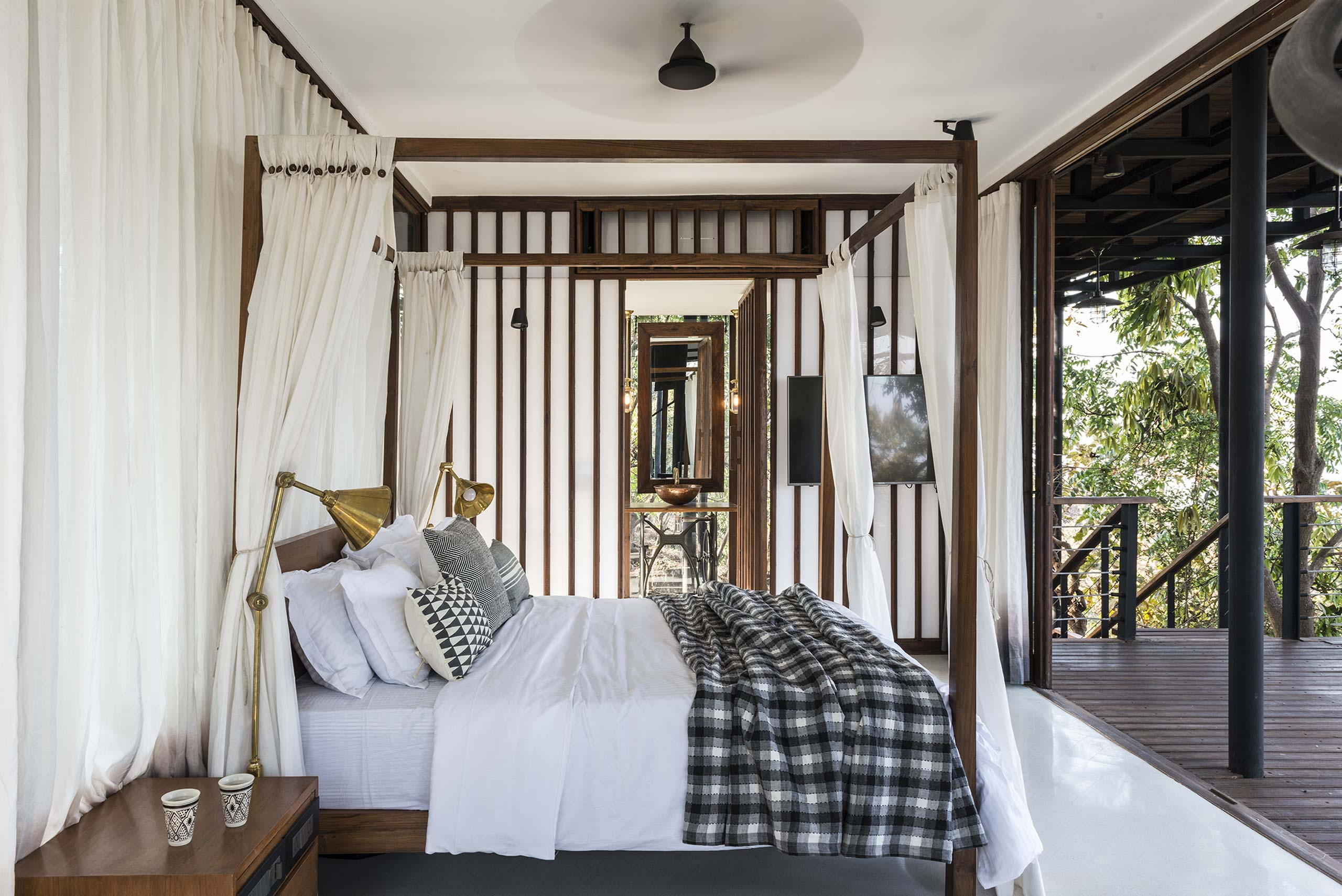 four poster bed at tala treehouse villa alibaug india