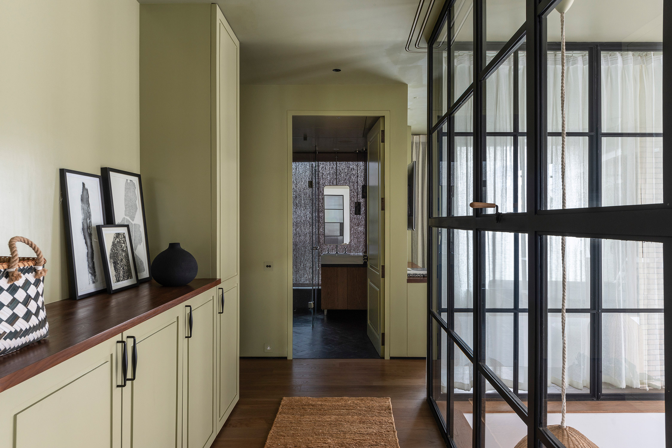 green storage cabinetry with steel windows