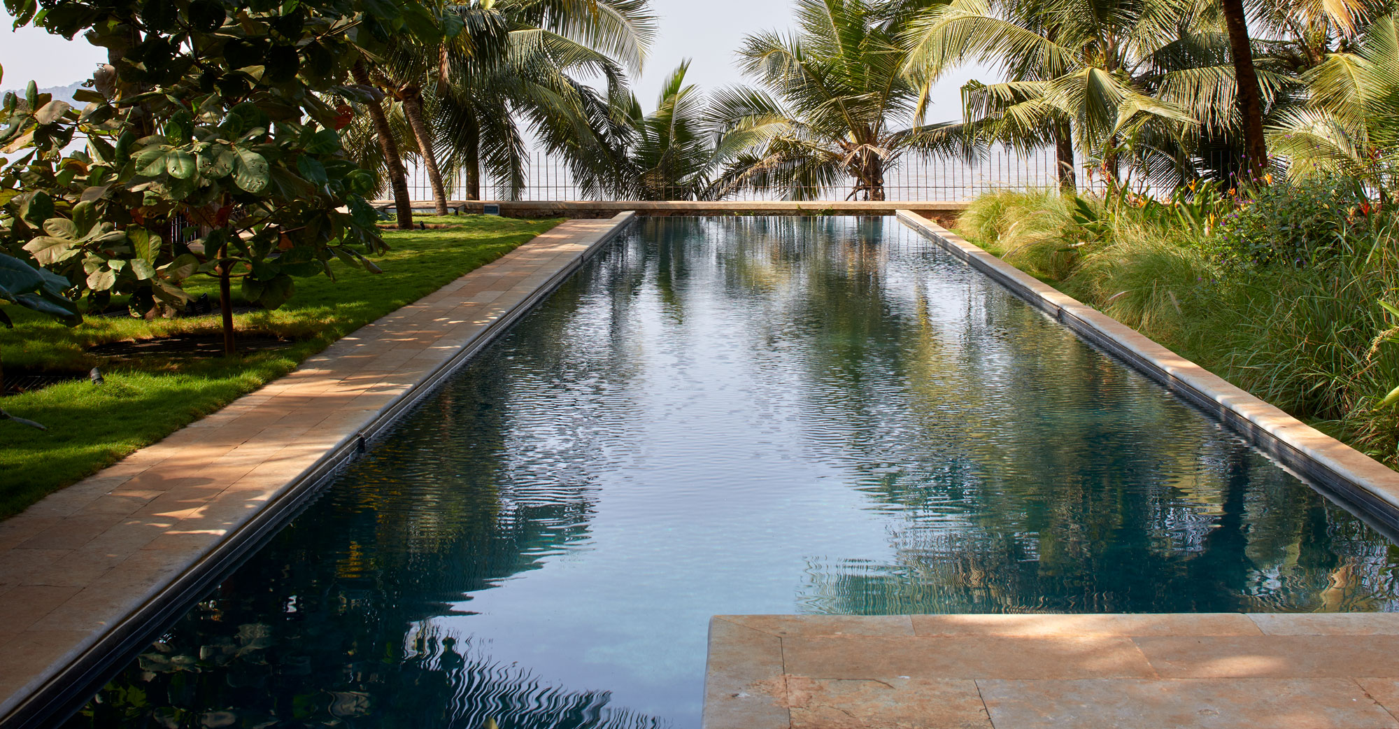 Swimming Pool at House in a Beach Garden
