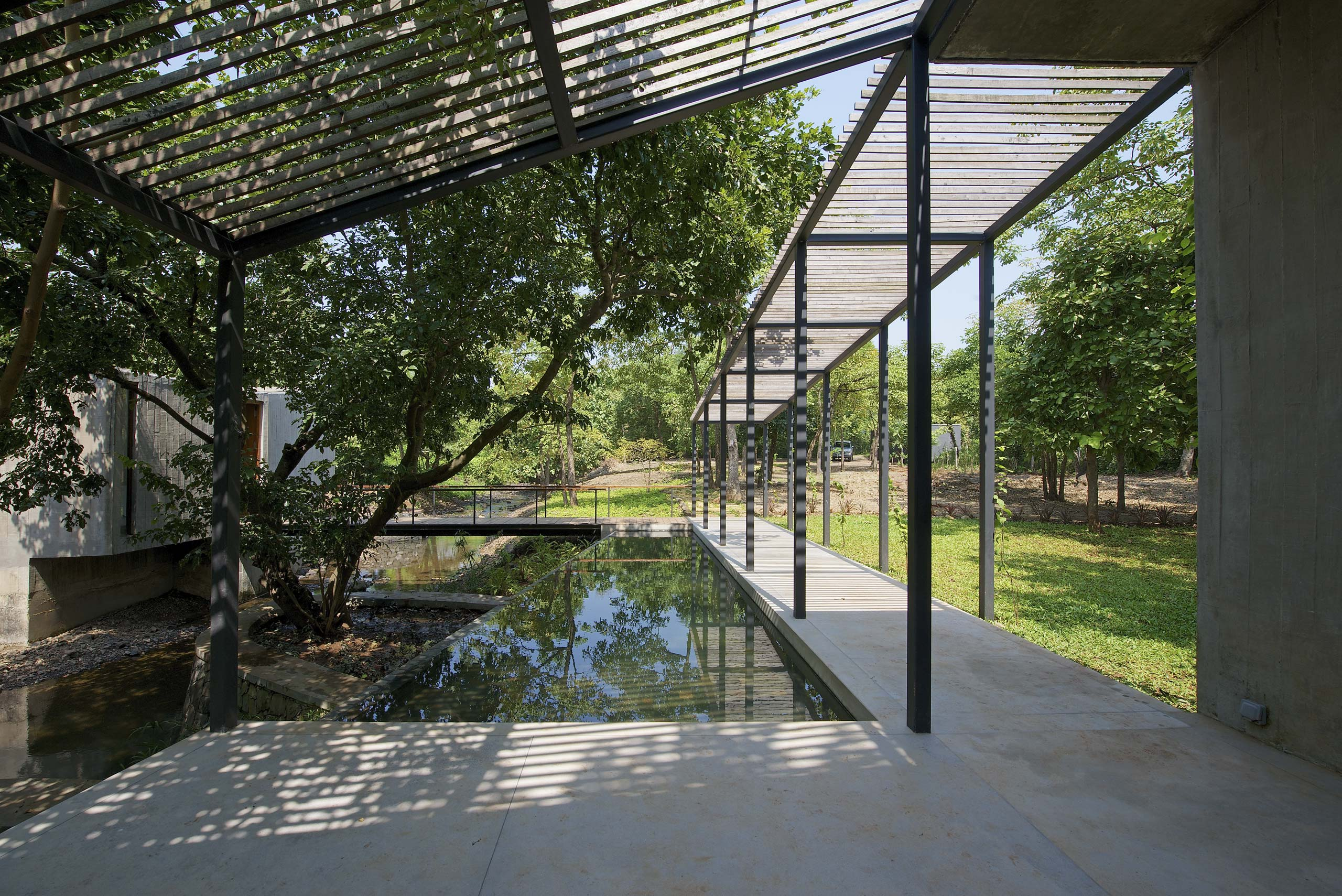 pool and entrance pavilion house on a stream by architecture firm in Mumbai