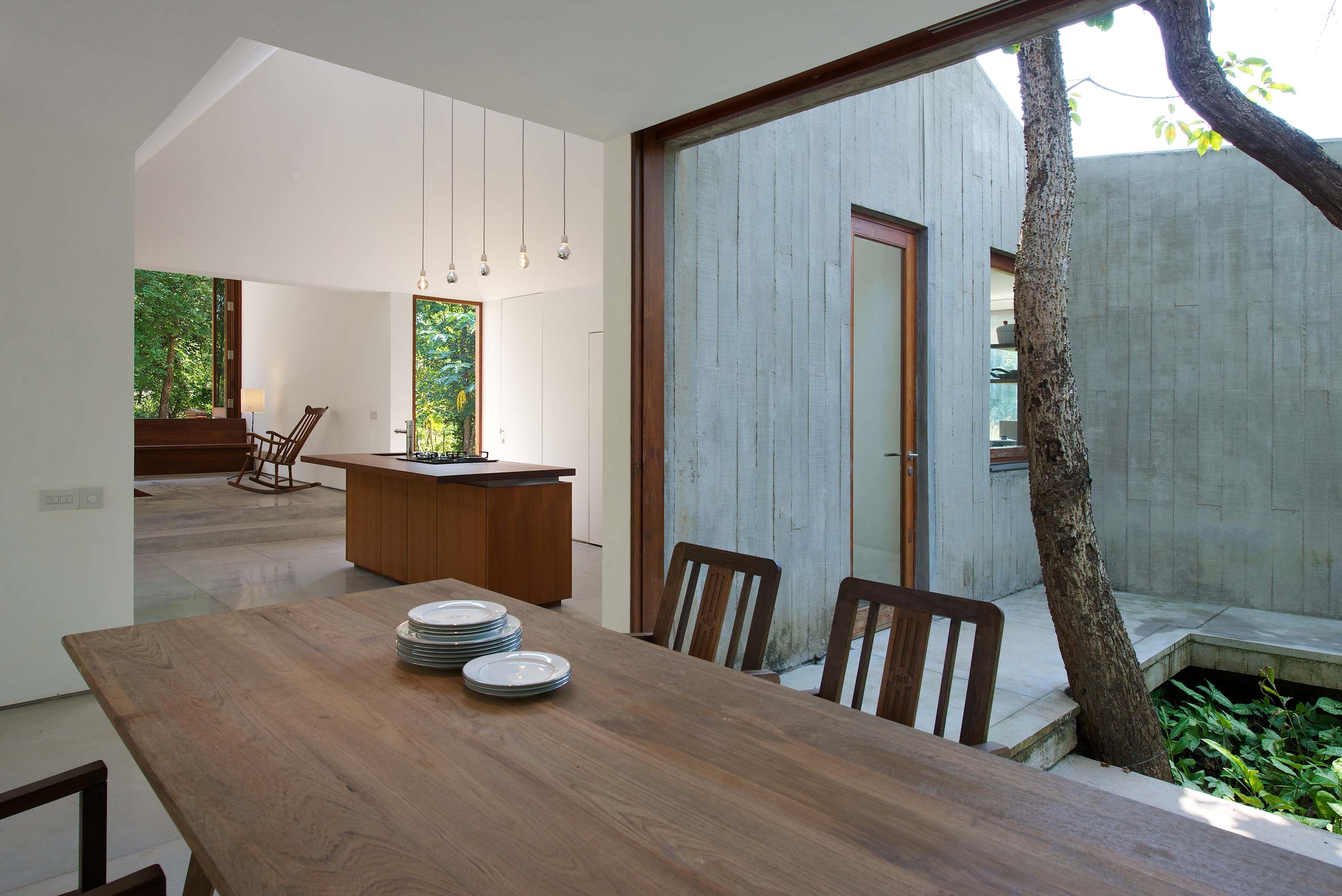 dining room island kitchen and courtyard house on a stream Alibaug india