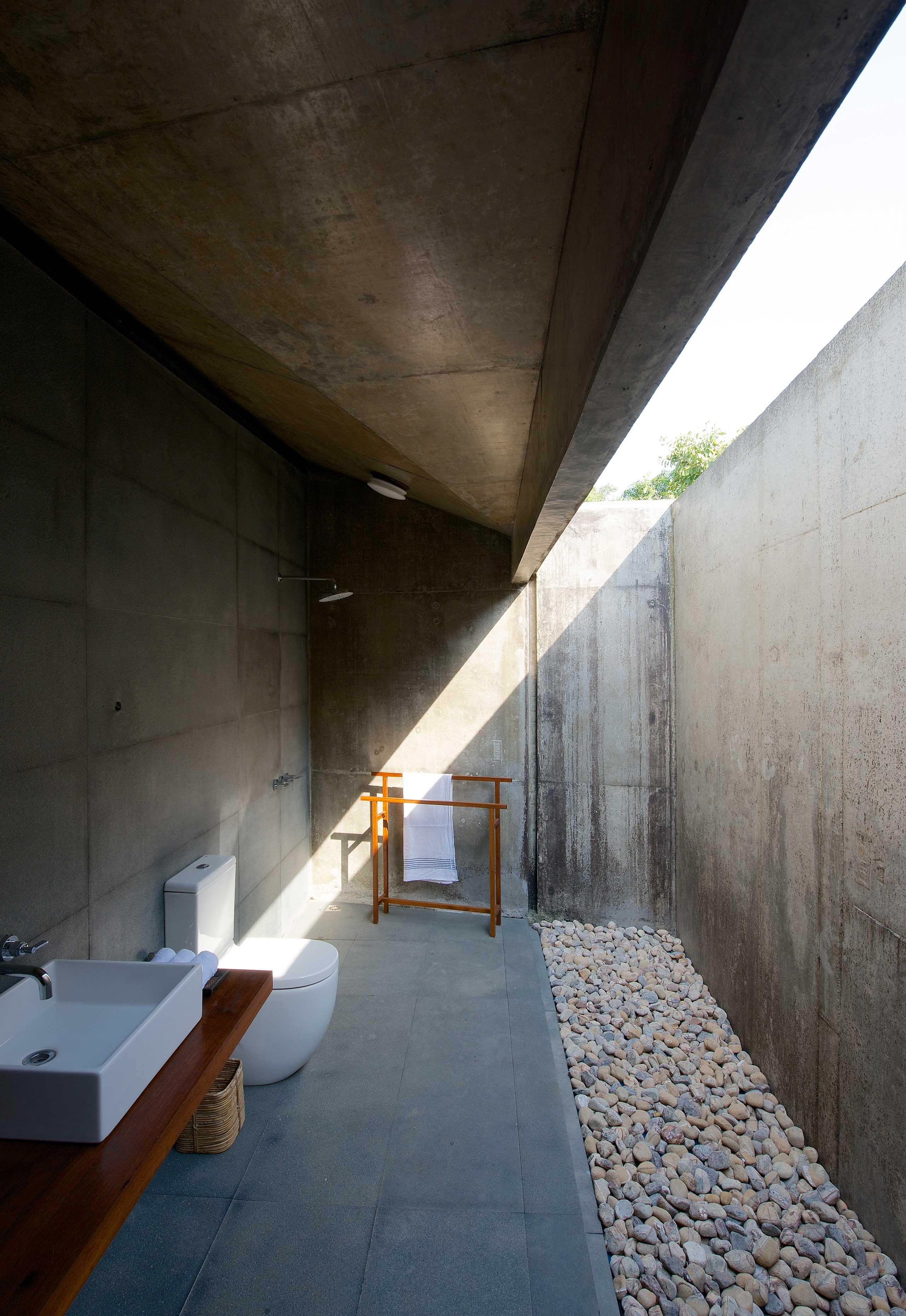 bathroom with courtyard house on a stream alibaug