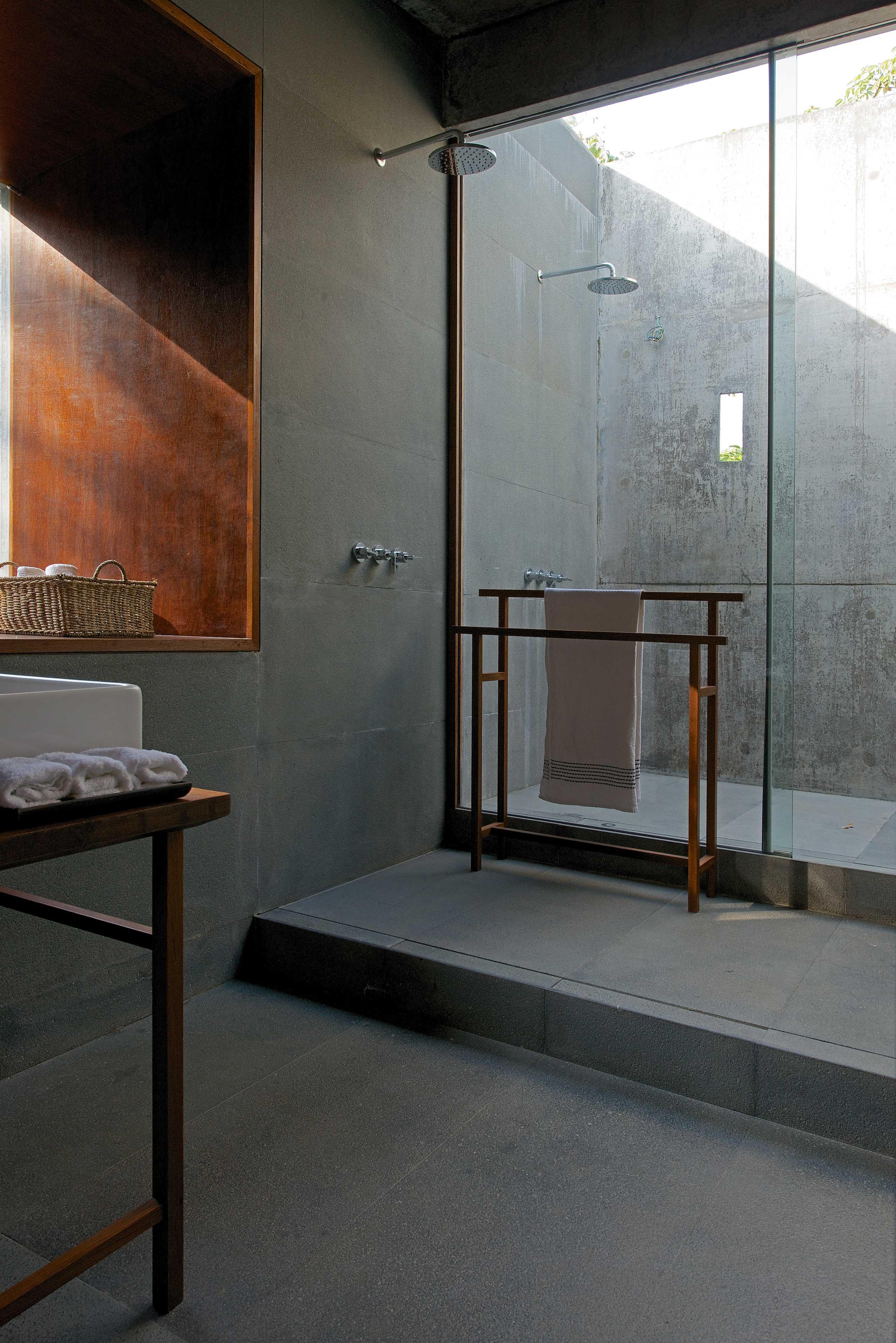 bathroom with outdoor shower house on a stream alibaug