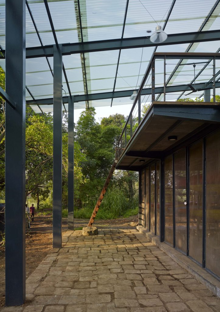 ladder to upper deck at magic bus learning pavilion Karjat india in Domus magazine