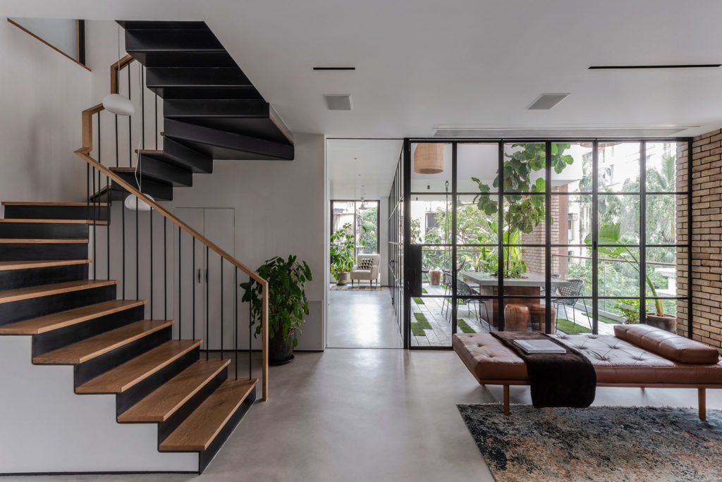 living room with cement floor and staircase